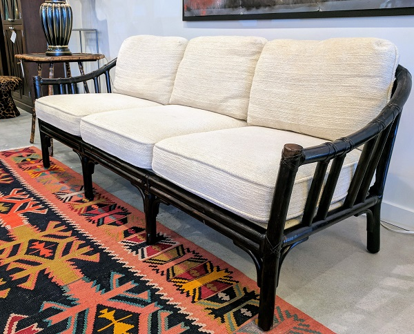 McGuire 3 seat sofa. Exact age unknown, Dark stained finish. Chenille upholstery. 1150.-