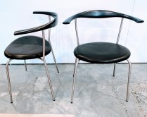 **ITEM NOW SOLD** Pair Hans J. Wegner 'PP701' side chairs. Produced in 2003 but never used. Black lacquer and leather. Original List: $1295.- each. Modele's Price: 1150.- pair