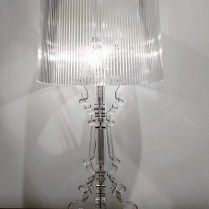 **ITEM NOW SOLD**Bourgie Table Lamp. Transparent polycarbonate. Candelabra base, lampshade is made with a plissé effect. Takes 3 type B incandescent bulbs with dimmer switch. Current List: $415.- Modele's Price: 225.-