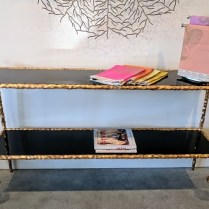 "**ITEM NOW SOLD** Global Views console. Iron base with gold finish, black granite shelves. Approximately 5 years old. Used only for staging in Four Seasons condo. Discontinued style. 60""l x 17""d x 33.75""h. Comparable current list: $2000. Modele's Price: 650.-"