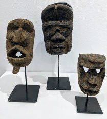 "African masks on stands, sold separately. 7""h: 75.- 10.75""h: 95.- 12.75""h: 150.-"