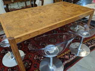 "Vintage dining table with two leaves, c.1980's. Oak frame with beautiful book matched burlwood top. 66""l x 38""w x 29""h. Two leaves @16""each = Max. 98"" long. 595.-"