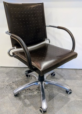 Leather desk chair. Adjustable seat height. Approx. 5 years old. Orig. $800. Modele's Price: 395.-