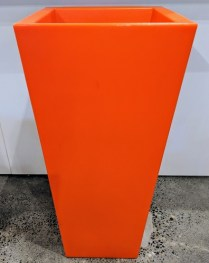 """**ITEM NOW SOLD** Serralunga tall square pot available in orange or red. Never used. 17"""" sq. x 37.5""""h. Original List: 445. each Modele's Price: 175. each. BUY TWO, GET ONE FREE (equal or lesser value)."""
