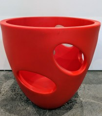 """Serralunga pot with """"windows"""" in red (2 available). Never used. 26""""d. x 26""""h. Orig. List: $335. each Modele's Price: 95. -each."""