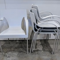 """**ITEM NOW SOLD** Set/4 Driande 'Sinuosa' stackable dining armchairs. Never used. Indoor/outdoor 21.5""""w x 19""""d x 31""""h. Original List: $1596. set/4 Modele's Price: 450. set/4"""