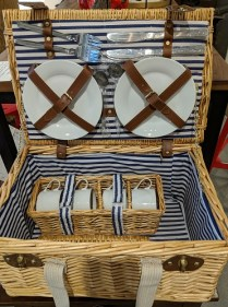"Wicker picnic basket; includes 4 each: plate/mug/knife/fork/ spoon. Used once. 18""w x 12""d x 9.25""h. 125.-"