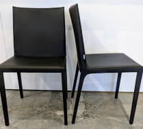 "**ITEM NOW SOLD** Set/4 Zanotta 'Ada' dining side chairs. Black leather with dark wenge stain on legs. Never used. 17.5""w x 21""d x 33.75""h. Orig. List: $1,655. each. Modele's Price: 2350.- set"