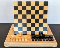 **ITEM NOW SOLD** Bauhaus chess set, designed by Josef Hartwig in 1923. Produced by Naef, Swiss made. Never used, box for pieces included. Current List: approx. $599. Modele's Price: 350.-