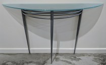 "Glass/steel demilune table. 52.5""w x 14""d x 32.75""h. Glass is frosted on bottom. 295.-"