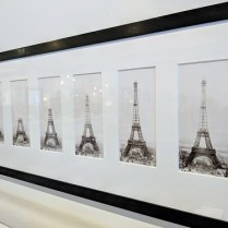"""**ITEM NOW SOLD** Framed series of Eiffel Tower photographs: """"Construction of the Eiffel Tower"""". Purchased 20-25 years ago in London. 70""""l x 17.75""""h 950.-"""