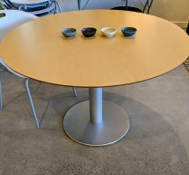 "Stua (Spain) 'Zero' pedestal dining table. Stored in original boxes, never used in a home. Beechwood top on aluminum base. 43.5""dia. x 28.25""h. Current List: $1,495. Modele's Price: 595.-"
