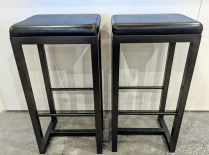 "Pair Zeus bar-height stools. Black leather seat on steel base. 16.5"" x 14.25"" x 32.5""h. Current List: $499. Each. Modele's Price: 495. Pair"