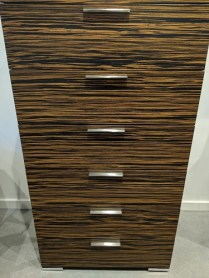 """**ITEM NOW SOLD** Doimo 'Webb' 6-drawer chest with natural ebony tigerwood veneers, stainless steel fittings. 31.5""""w x 22""""d x 58""""h. 1295.-"""