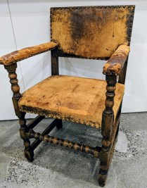 "Vintage armchair with distressed leather. Rustic chic! 22.5""w x 20""d x 35.75""h. 250.-"