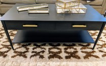 "West Elm coffee table in hot-rolled black steel finish, brass drawer pulls. Less than one year old. 42""w x 22""d x 16.75""h. (some scratches on top) Orig. List: $399. Modele's Price: 175.50"