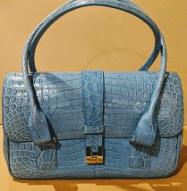"""Lamberston Truex crocodile handbag. Interior pockets, fully lined in suede. 13""""w x 6""""d plus straps. Orig. List from Saks Fifth Avenue: $7,500. Modele's Price: 1750.-"""