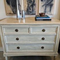 "**ITEM NOW SOLD** Vintage chest of drawers, purchased from 1st Dibs. Custom painted finish, fabric covered panel drawer liners. 44""w x 21.5""d x 36.75""h. 1150.-"