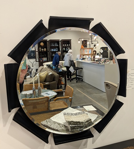 "Round mirror with petal frame, from Lucca in Los Angeles. 29"" dia. Orig. List: $1250. Modele's Price: 495.-"