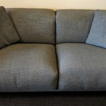"**ITEM NOW SOLD** Design Within Reach 'Kelston' sofa. 18 months old. Pebble Weave fabric in 'Pumice'. Articulating headrest adjusts from low to high. 93.5""w x 44""d x 25""-35""h. Current List: $6,995. plus shipping. Modele's price: 2850.-"