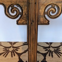 Antique Chinese altar table, detail of scroll design on legs.