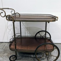"""**ITEM NOW SOLD** Vintage bar cart with removable top tray and 4 bottle caddies. 31""""l x 22.5""""w x 29""""h. 395.-"""