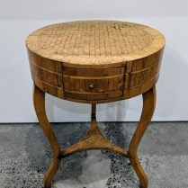 "**ITEM NOW SOLD** Vintage side table covered with inlaid veneer. Single drawer. Unique and charming piece. 18.5"" dia. x 26.25""h. 425.-"