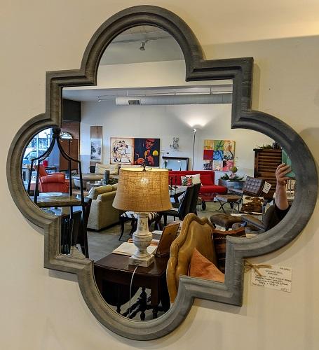 "Quatrefoil mirror with 'cement' faux finish frame. 44"" x 44"". 250.-"