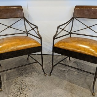 """Pair metal arm chairs, maker not known. Lovely patina on metal frames, faux leather seats. 23.5""""w x 26""""d x 34.75""""h. 395. pair"""
