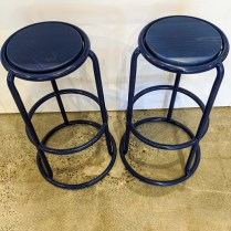"""Pair bar height stools. Tubular steel with wooden seats. Powder coated finish in blue...plays well with the Louis Poulsen sconce (see in Lighting). Seat height: 30.25"""" 175.- pair"""