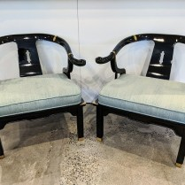 "Pair vintage Century black lacquered ""horse-shoe"" chairs. Includes pair matching throw pillows. 31""w x 27""d x 30""h. 1500.- pair"