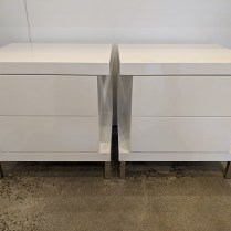 "Pair white lacquer nightstands with two drawers. Purchased form One Kings Lane. Customized with after-market steel legs. 21.75""w x 17.75""d x 22.25""h. Orig. List: $1,000. pair. Modele's Price: 450. pair"