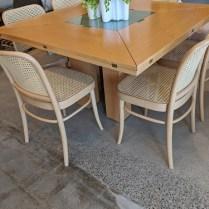 "Tranekaer (Denmark) 'Cirkante' dining table. Purcahsed from Egbert's in 2003. Seats 8-12. Beech veneer. 48.75"" sq. x 29""h opens to 78"" sq. x 28""h. Orig. List: $3,000. Modele's Price: 1395.-"