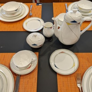 Villeroy and Boch 'Trio' dinnerware set. 67 pieces, dishwasher/microwave safe. Current list: over $1,200. Modele's Price: 550. set (Shown on Chilewich Bamboo placemat in Mandarin 15. each)