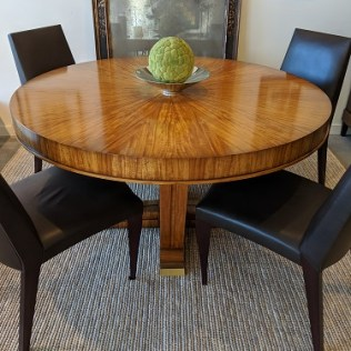 """William Switzer 'Merisier' table from the Lucien Rollin Collection. Lemon wood veneers, no longer in production. Very light use, beautiful condition. 55.75"""" dia. x 30.5""""h, plus one 19.75"""" leaf. Orig. List: $17,000. Modele's Price: 4500.-"""