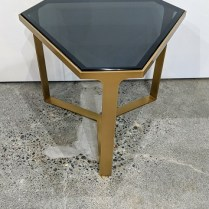 """Donghia 'Form' drink table with satin brass base and black glass top. Showroom sample, never used in a home. 19.5"""" x 22.5"""" x 17""""h. Orig. List: $3,500. Modele's Price: 950.-"""
