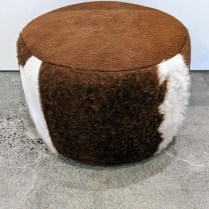 "Room & Board 'Lind' cowhide ottoman. Five years old. 21.5"" dia. x 15.5""h. Current List: 499. Modele's Price: 250.-"
