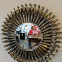 "Sunburst mirror, metal frame silver finish. 19"" dia. x 3.5""d. 145.-"