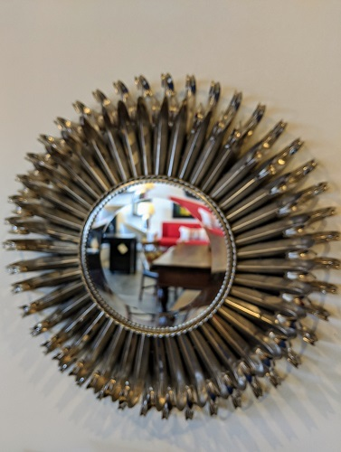 "**ITEM NOW SOLD** Sunburst mirror, metal frame silver finish. 19"" dia. x 3.5""d. 145.-"