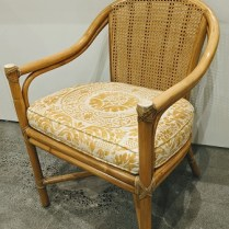 "Vintage McGuire armchair with Fortuny-covered seat cushion. 22.25""w x 22""d x 31.25""h 550.-"