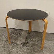"""**ITEM NOW SOLD** Vintage Rafn (Denmark) side table. Purchased from Egberts c. 1999. Beech with black melamine top. 24.5"""" dia. x 19.5""""h. 125.-"""