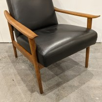 "**ITEM NOW SOLD** West Elm 'Mid-century Show Wood' chair. 2 years old, black leather seat/back. Solid ash arms and legs. 26.5""w x 30.5""d x 30.5""h. Current List: $949.05 Modele's Price: 495.-"