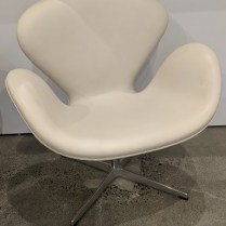 "Fritz Hansen 'Swan' chair in leather. Designed by Arne Jacobsen in 1958. Purchased in 2007, very light use. 29.5""w x 26.75""d x 31""h. Current list: $9.615. Modele's Price: 4250.-"