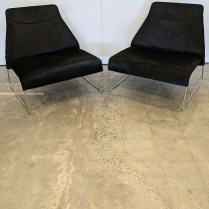 """Pair B&B Italia 'Lazy '05' lounge chairs, designed by Patricia Urquiola. Very lightly used, hair-on-hide leather upholstery. 31.5""""w x 28.75""""d x 29.5""""h. Current list: over $6,000. pair. Modele's Price: 2950. pair"""
