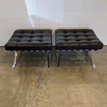 "Pair Knoll 'Barcelona' leather footstools, purchased in 2009. Designed by Mies Van der Rohe in 1929. 25.5""w x 23""d x 15.5""h. Current list: $5,207. pair. Modele's Price: 2500. pair"