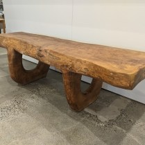"**ITEM NOW SOLD** Rustic carved wood bench, carved from a single piece of wood. Origin not known, dense and heavy hard wood. 67""l x 25""w x 20.75""h. 2500.-"