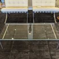 """**ITEM NOW SOLD** Spectrum (Netherlands co.) coffee table, purchased in Vancouver, B.C. in 2004. No longer in production. Brushed stainless steel and glass. 47.25""""l x 23.5""""w x 11.5""""h. 375.-"""