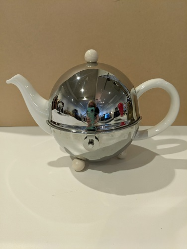 "1837 TWG Tea teapot with polished stainless steel insulated cozy. 9"". x 6""h. Current list: $275. Modele's price: 135."