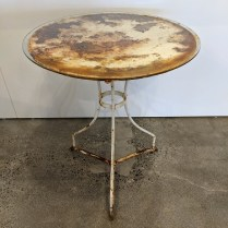 """Rustic metal table, used outdoors to achieve this great patina. Includes glass top. 25"""" dia. x 30.25"""". 95.-"""