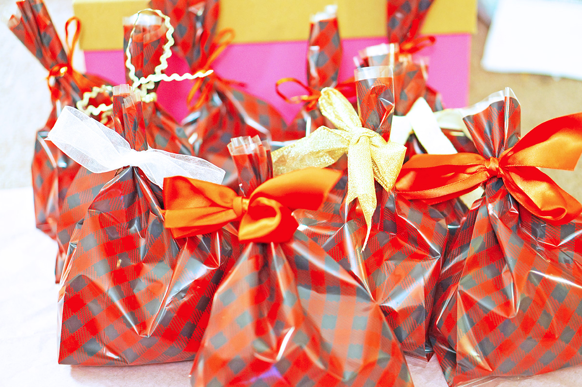 these cute christmas goodie treat bags are a great way to give a little something to everyone for the holidays whether its for coworkers friends family